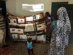 the quilt is unfurled at the center (The Advocacy Project) Tags: africa training outdoors justice soap women peace quilting local mali income womensrights fellowship survivors trainingcenter soapmaking communitybuilding peacefellowship advocacyproject confidencebuilding sinisanuman
