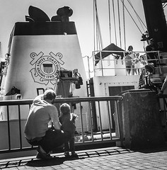 Fleet Week (TMimages PDX) Tags: street city people urban blackandwhite monochrome portland geotagged photography photo ship waterfront image streetphotography streetscene seawall sidewalk photograph pedestrians pacificnorthwest vignette fineartphotography iphoneography