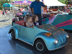 """Paul and Inde Ride the Cars at the Rose Festival • <a style=""""font-size:0.8em;"""" href=""""http://www.flickr.com/photos/109120354@N07/27821830146/"""" target=""""_blank"""">View on Flickr</a>"""