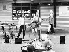 Sister street performers. #streetphotography #blackandwhitephotography #travelphotography #olympus #olympusEM5 #olympusOMD #explorebc #travelphotography #granvilleisland #MFT #M43 (Derman01) Tags: streetphotography olympus granvilleisland blackandwhitephotography travelphotography m43 mft explorebc olympusomd olympusem5