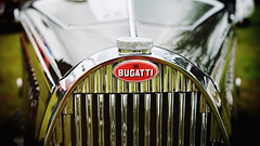 Bugatti in chrome (Eric Flexyourhead (shoulder injury, slow)) Tags: canada detail car zeiss emblem logo french shiny bc bokeh britishcolumbia chrome badge grille northvancouver bugatti 169 vignette radiator fragment waterfrontpark shallowdepthoffield 2016 55mmf18 italianfrenchcarbikefestival sonyalphaa7 zeisssonnartfe55mmf18za