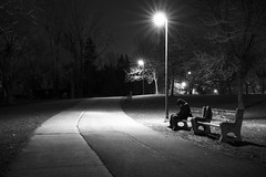 Long Journey Wears Me Out (bonaphoto) Tags: street longexposure light sleeping bw canada man lamp monochrome self dark sitting break nightshot post quebec path montreal empty spotlight trail human tired rest grayscale benches selfphoto starburst iledessoeurs verdun nunsisland selfcamera canoneos7d canonef2470mmf28lisiiusm