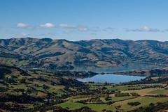 Very Calm (Jocey K) Tags: autumn sea newzealand sky water clouds reflections southisland bankspeninsula tress hilltop hillls