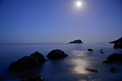 Kiberick Cove by moonlight (AndyLewis83) Tags: blue sea moon water night coast lowlight rocks cove tide silhouettes rocky moonlit hues moonlight tranquil soothing
