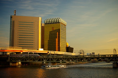 Asahi HQ by Sumida River (Moonie's World) Tags: city sky urban color water glass japan horizontal architecture modern asian gold tokyo evening office holidays asia cityscape waterfront asahi headquarters nobody nopeople landmark icon structure asakusa goldenhour philippestarck eastasia sumidariver capitalcities nolens buildingexterior asahibeerhall stockcategories builtstructure asahibreweries fotopedia