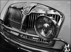 MGA Fog Lamp & Grille (NoJuan) Tags: bw vintage blackwhite mg nikkor sportscar autodetails nikkor35mmf18gafs 35mmf18afnikkor nikond5100 xxxdriveinissaquah pacificnorthwestcarshows