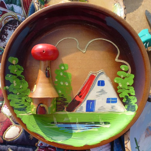 wooden dish with house and windmill