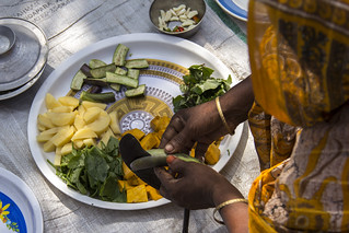 Preparing vegetables for a fish curry in Rangpur, Bangladesh. Photo by Holly Holmes, 2013