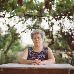Portrait of a senior woman (Nasos Zovoilis) Tags: life old grandma portrait people woman brown white color senior beauty face look proud lady female rural scarf hair greek happy person clothing women europe mediterranean european village looking dress adult grandmother folk expression background character postcard teeth traditional country gray mother mani pride greece human mature elderly age experience elder laugh older aged redneck balkans wisdom tradition middle granny widow retired suffering aging tough wrinkles wrinkle isolated textured peasant villager caucasian