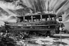 at a bus stop- (big andrei) Tags: leica bw lens boat cyprus busstop levis m9 501 trielmarm potamosliopetriou 283550mm40