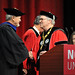 Chancellor Randy Woodson (right) congratulates Hayden White on receiving a Doctor of Humane Letters degree.