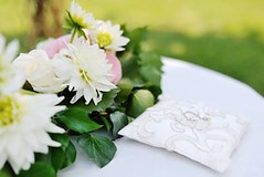 wedding rings on a white pillow near flowers (AAevent) Tags: wedding two italy white flower love horizontal gold togetherness engagement couple holidays married symbol lace anniversary no traditional unity ceremony objects happiness husband jewelry romance ring pillow rings celebrations bouquet nuptials cushion newlywed marry agreement