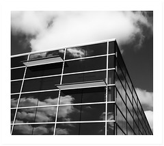 Ledge (Demmer S) Tags: windows sky urban blackandwhite bw cloud reflection building window glass monochrome lines arquitetura architecture modern clouds facade buildings reflections reflecting design blackwhite office pattern exterior box geometry contemporary perspective modernism officebuilding structure architectural line reflect repetition reflective architektur form boxed shape parallel offices architectuur modernist rectangles arkitektur blackwhitephoto rectange arhitektura blackwhitephotos archidose