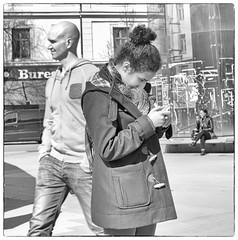 Texting (Xerethra) Tags: people blackandwhite bw woman girl 35mm geotagged spring nikon europa europe sweden stockholm candid may streetphotography streetlife swedish streetphoto sverige maj vår svartvitt nikon35mm människor 2013 d80 stockholmslän nikond80 svenskt stockholmslän