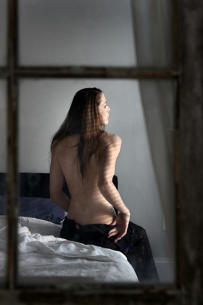 Girl Undressing In Window