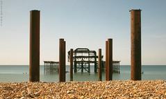 Burnt Out (peterphotographic) Tags: uk longexposure sea england abandoned beach sussex coast seaside brighton britain decay westpier eastsussex burntout brightonpier neutraldensity nd110 canong12 camerabag2 img4416cb2filmgedwm