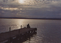 Departures (lluiscn) Tags: light sun sunlight luz sol 35mm landscape persona laguna aigua llum llac paisatge contrallum nvols albufera analogic valncia nvol rajos ennuvolat nuvolat sentat