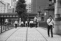 sense of self (edwardpalmquist) Tags: street city travel bridge urban blackandwhite plant man building tree nature monochrome japan architecture train subway tokyo crowd akihabara