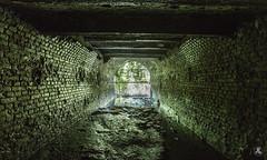 Unseen Green Obscene (AnotherStepAway) Tags: light urban wet water river dark underground darkness exploring deep tunnel drain explore tunnels exploration culvert ue drainage urbex draining