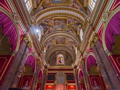 St Paul's Cathedral (Ian M Bentley) Tags: pink red art beautiful yellow architecture gold worship purple cathedral paintings peaceful grand olympus malta calm aisle serene baroque rc tranquil saintpaulscathedral opulent romancatholic omd mdina 1702 frescoes lavish worksofart ancientcapital em5 lorenzogafà mdinacathedral archdioceseofmalta metropolitancathedralofsaintpaul