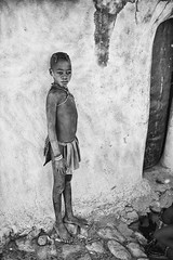 Himba Girl (alisdair jones) Tags: africa house girl wall tribe namibia himba ef35mmf14lusm