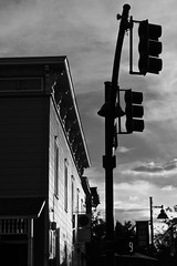 Evening Contrasts (tim.perdue) Tags: black white bw monochrome ohio olympus omd em10 evening contrasts light shadow traffic corner building wall sunlight sky clouds silhouette powell olentangy liberty street