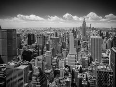Midtown Manhattan (Stefan K0n@th) Tags: city nyc blackandwhite bw newyork monochrome skyline architecture rockefellercenter empirestatebuilding topoftherock midtownmanhattan fujixpro1 fujinonxf14mm28