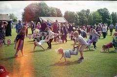 Wheelbarrows (moroseduck) Tags: summer film race 35mm children lomo lomography lightleaks fete vista agfa 35 cosmic wheelbarrow