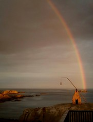 "Rainbow at ""Worlds End"" (maya the viking_girl) Tags: sea summer sky lighthouse nature water june norway landscape rainbow rocks dramatic sombre magical tjme tiltinglantern"