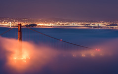 The Tales of two Bridge (Simon Huynh) Tags: ocean sanfrancisco city light fog clouds lights cloudy foggy baybridge karl goldengatebride karlthefog