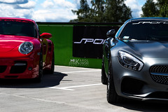 Eye to Eye (kdymkowski) Tags: show blue red sky green eye cars colors car sport race speed grey lights mercedes 911 headlights exposition turbo vehicle amg carrera gts porshe