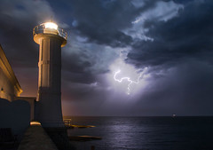 A safe light under the storm (Cath Dominguez) Tags: sea lighthouse storm faro lightning temporale fulmine