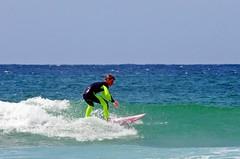 Aggression (leszee) Tags: ocean uk blue sea sky sun beach water sport st swim coast sand cornwall surf pentax surfer wave surfing porth ia surfboard aggression stives ives k5 waverider ridingawave porthmeorbeach pentaxdslr surfacewatersport pentaxk5 porthla stiascove