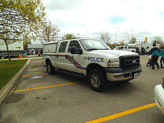 Halton Regional Police marine unit (2) (car show buff1) Tags: rescue ontario canada ford logo chief tahoe police victoria crest chevy dodge crown ladder squad incident ems charger pursuit commander caprice pumper ppv battalion halton f250