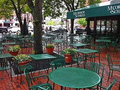 Not a Sidewalk Sort of Day (AntyDiluvian) Tags: wet rain boston table restaurant spring cafe chairs massachusetts patio sidewalk quincymarket faneuilhall bostonist faneuilhallmarketplace mccormickandschmick