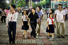 Family night out (Lil [Kristen Elsby]) Tags: nightphotography travel family night asia streetphotography korea editorial amusementpark topv3333 funfair northkorea pyongyang eastasia dprk travelphotography democraticpeoplesrepublicofkorea chosŏnminjujuŭiinminkonghwaguk kaeson dprofkorea kaesonyouthpark canon5dmarkii