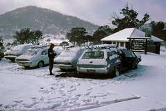Sawyer's Hill hut, 1984 (NettyA) Tags: snow cars clouds skiing australia crosscountry hut 1984 nsw newsouthwales kodachrome holden scannedslide kosciuszkonationalpark 35mmslidefilm theresthouse sawyershill