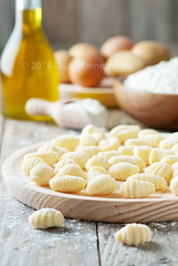 Italian gnocchi (Oxana Denezhkina) Tags: italy food white cooking cheese dinner cuisine wooden healthy italian mediterranean raw background wheat traditional pasta fresh gourmet potato homemade meal noodle diet cooked flour gnocchi culinary dumpling gastronomy nutrition ingredient patata prepared uncooked