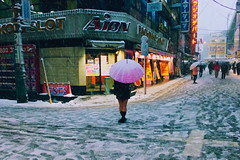 Standing Out (OzGFK) Tags: street winter snow cold girl japan umbrella canon tokyo asia freezing powershot akihabara snowing s100 maidcafe