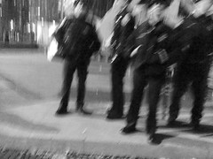 Pillow Fight: San Francisco Valentine's Day Tradition - B&W Blur of SFPD (Lynn Friedman) Tags: sanfrancisco california plaza usa love fun community energy chaos cops waterfront 14 group guard feathers police security valentine event standby single depression embarcadero friendly annual therapy tradition february pillowfight valentinesday mentalhealth sfpd controlled antidote justinhermanplaza remedy cathartic 94111 nolove justinherman nogirlfriend lynnfriedman noboyfriend