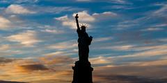 Coloured Statue of Liberty (Rafael Gonzalez V.) Tags: new york city nyc sunset usa ny atardecer manhattan united v states rafael statueofliberty crepusculo ocaso gonzlez estatuadelalibertad thisisnewyorkcity 201311