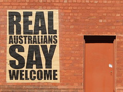 But what's a real Australian? (mikecogh) Tags: poster refugees politics adelaide cbd welcome migration campaign westend confusing alternative persuasion crowdsourcing peterdrew crowdfunding