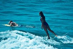Oceanside Pier (EthnoScape) Tags: ocean california sea beach girl beautiful beauty female pier surf waves feminine surfer wave surfing bikini oceanside surfboard surfers fiberglass brunette onepiece surfistas bathingsuit wetsuit lycra baador oceansidepier surfista surfergirl neoprene ethnoscape ethnoscapeimagery