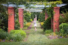 Jumping for Lollipops (Geoff Livingston) Tags: girl garden kid spring jump jumping daughter lollipop