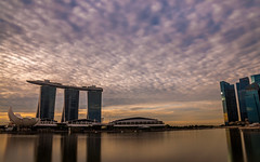 Singapore City Skyline during dawn (jh_tan84) Tags: city longexposure blue water beautiful skyline clouds marina photography dawn bay singapore perspective fluffy awareness marinabaysands