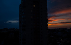 The Sky separating building (modestmoze) Tags: city pink blue houses windows sunset sky orange white black streets building cars up clouds buildings dark grey lights evening spring cityscape shadows may front indoors inside parked tall lithuania vilnius foreground infront 2016 500px