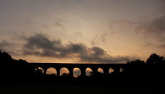 Evening Viaduct (music_man800) Tags: uk trip pink trees light sunset sky orange black color colour nature beautiful silhouette architecture night train canon dark photography grey evening pretty day arch colours afternoon natural outdoor dusk united creative may railway kingdom viaduct colourful archway shape essex colchester edit chappel gimp2 700d