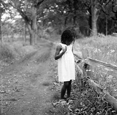 when time stands still (gabster_ro) Tags: road park wood blackandwhite black flower tree cute film nature floral monochrome childhood forest fence outside outdoors flora child outdoor path ilfordhp5 africanamerican copyspace multicultural ethnic yashica multiethnic