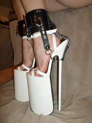 Platform Sandals with Heel Restraint Chains in Place (KAFOmaker) Tags: white12inchplatformsandals bondage heel heels platform platforms sandal sandals ankle strap straps strapped anklestrap sexy leather cuff chain chains chained lock locks locked locking