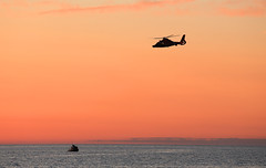 Practing (GLC 392) Tags: life sunset sun lake west station silhouette set coast boat us amazing dusk dolphin michigan air awesome guard craft special helicopter law enforcement purpose ludington h65 spcle mh65 mh65c 33foot
